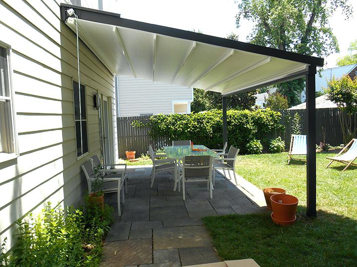 pergola with retractable canopy white pergola awning on a white house extending over backyard patio metal pergola with retractable canopy uk